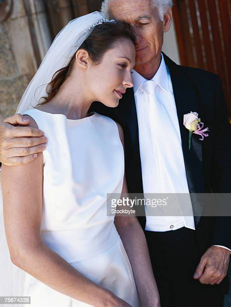 Bride with her father outside church