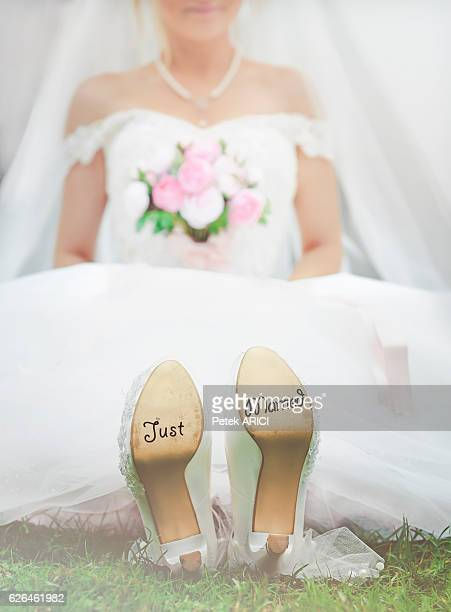 Bride with 'Just Married' written on shoes