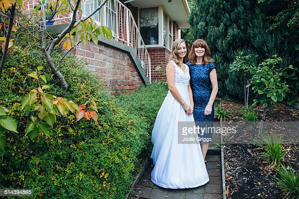 Bride with Mother standing outside family home