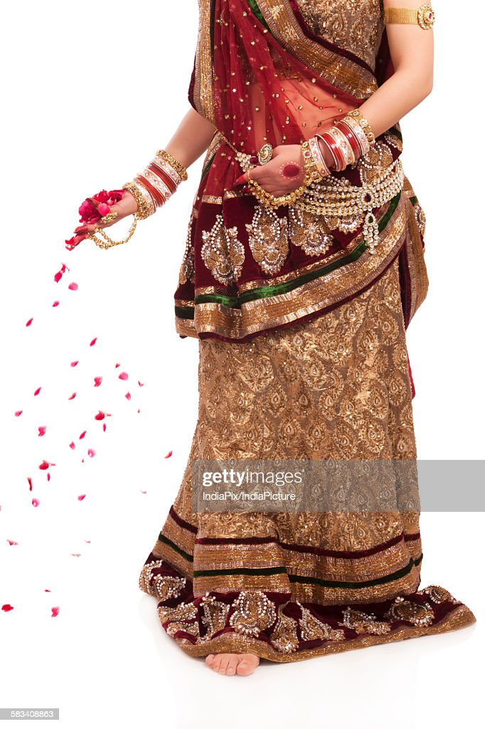 Bride with rose petals in her hand : Stock Photo