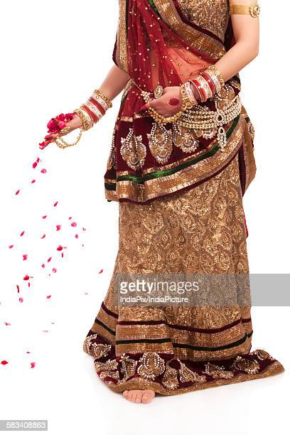 bride with rose petals in her hand - bangle stock pictures, royalty-free photos & images