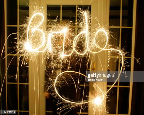 bride written in sparklers - hutton stock photos and pictures
