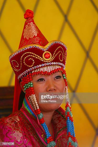 Bride Xia Shujuan awaits the world's tallest man Bao Xishun during their traditional Mongolian wedding ceremony at Genghis Khan's Mausoleum on July...