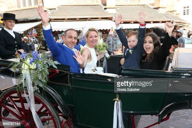Bridegroom Erdogan Atalay and his bride Katja Ohneck with Amira Pauletta Pollmann daughter of Erdogan Atalay and Maris Atalay son of Erdogan and...