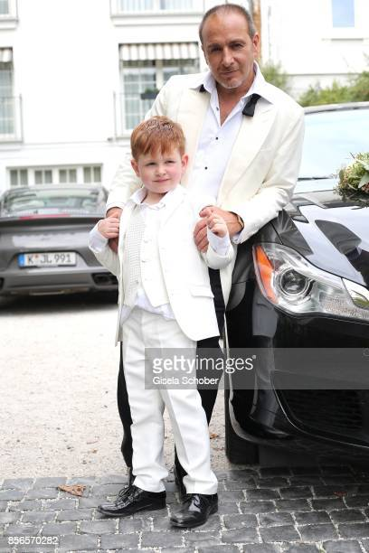 Bridegroom Erdogan Atalay and his son Maris Atalay during the church wedding of Erdogan Atalay and Katja Ohneck at Heidelberg Castle on September 30...