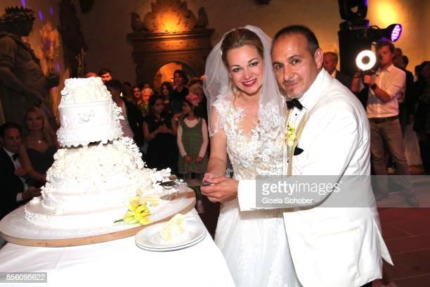 Bridegroom Erdogan Atalay and his wife Katja Ohneck during their church wedding at Heidelberg Castle on September 30 2017 in Heidelberg Germany