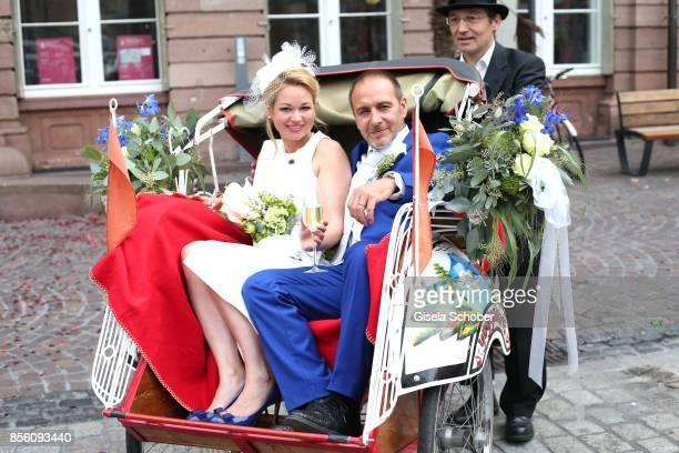 Bridegroom Erdogan Atalay and his wife Katja Ohneck leave their civil wedding in a ricksha on September 28 2017 in Heidelberg Germany