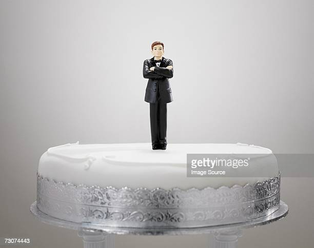 bridegroom figurine on a cake - wedding cake figurine stock pictures, royalty-free photos & images
