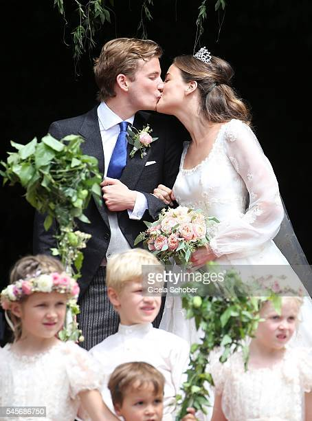 Bridegroom FranzAlbrecht zu OettingenSpielberg and his wife Cleopatra zu OettingenSpielberg kiss after the wedding of hereditary Prince FranzAlbrecht...