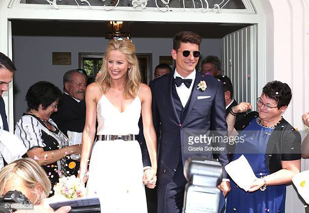 Bridegroom Mario Gomez and his wife Carina Wanzung during their wedding at registry office Mandlstrasse on July 22 2016 in Munich Germany
