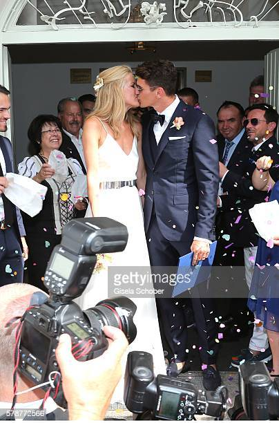 Bridegroom Mario Gomez kisses his wife Carina Wanzung during the wedding of Mario Gomez and Carina Wanzung at registry office Mandlstrasse on July 22...