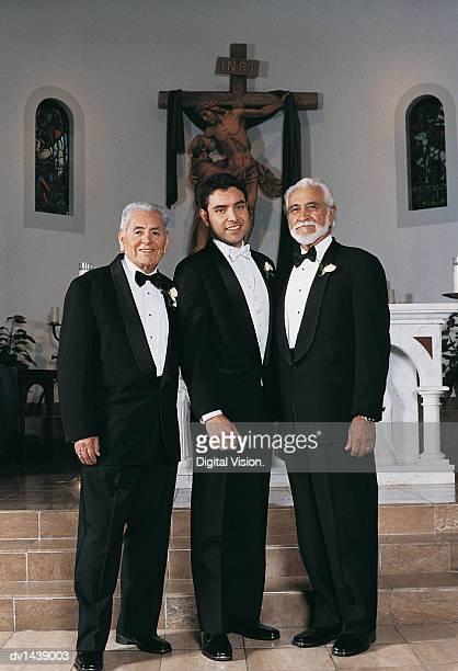 Bridegroom Standing With Older Men at Church Altar