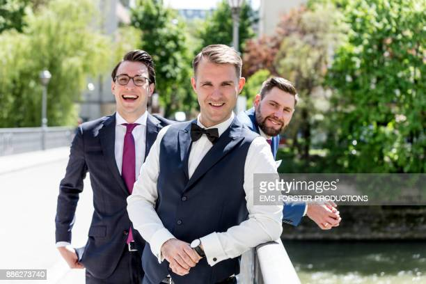 bridegroom with his groomsmen on the way to the church