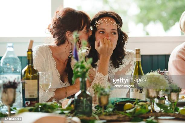 brides at wedding reception - marryornot stock pictures, royalty-free photos & images