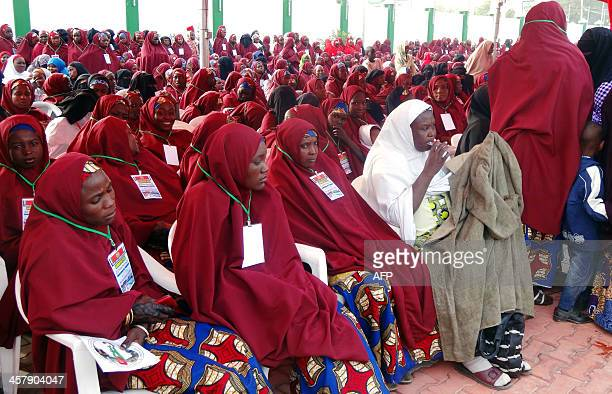 Brides attend a wedding feast at the Kano state governor's office after taking part in a mass wedding at the central mosque in Nigeria's second city...