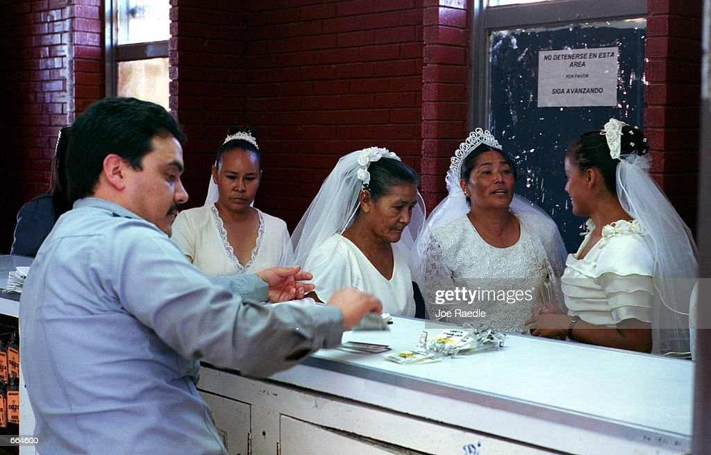 Brides check in at the front desk at a prison October 2, 2000 in Ciudad Juarez, Mexico. Mexican law allows for inmates to get married inside the prison walls. 5 current and former inmates were married in a Christian ceremony.
