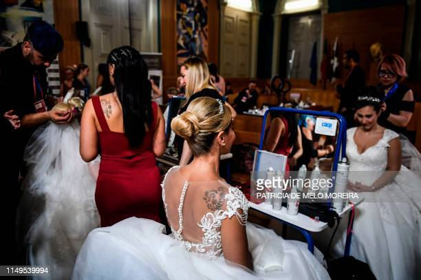 Brides get ready for their marriages before celebrating a multiple wedding ceremony in Lisbon during Saint Anthony's day on June 12 2019 It is...