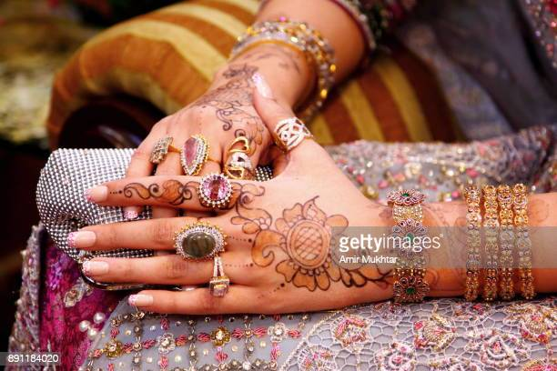 bride's hands - pakistani gold jewelry stock pictures, royalty-free photos & images