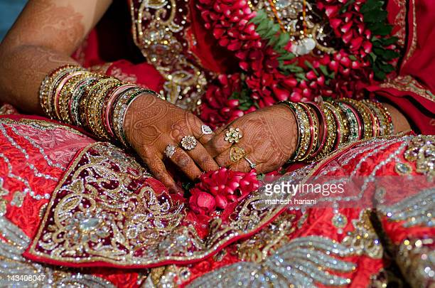 Bride's hands with henna and jewelry