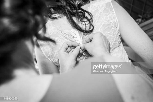 Bride's mother wearing her daughter for the wedding day. Italy