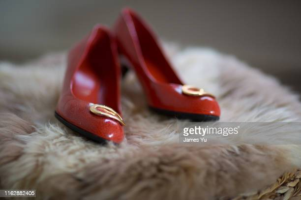bride's red shoes - 赤の靴 ストックフォトと画像