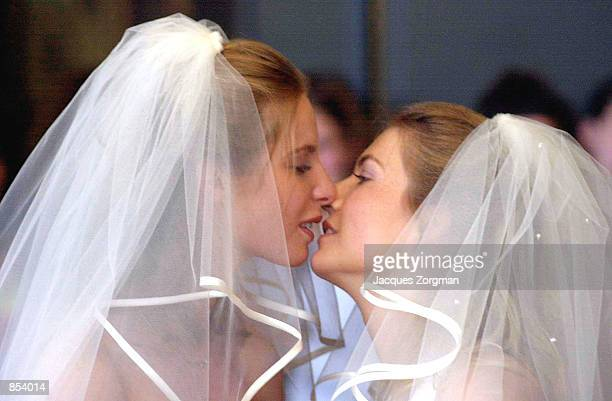 Brides Tijana Schouten left and Ilonka Brouwer kiss during their wedding ceremony April 27 2001 in The Hague The Netherlands The Netherlands are the...