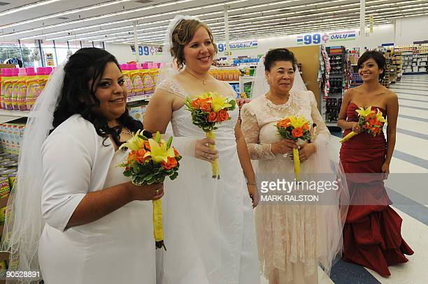 Brides wait for their 99 cent wedding ceremony at the 99 cent store in Los Angeles on September 9 2009 The budget supermarket chain helped nine happy...