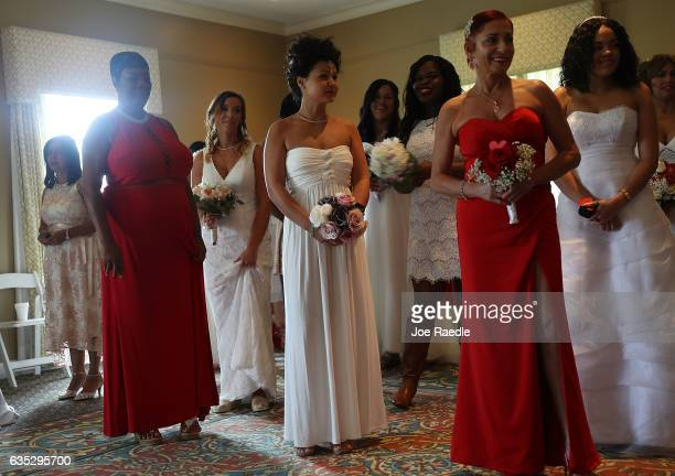 Brides wait to participate in a group Valentine's day wedding ceremony at the National Croquet Center on February 14 2017 in West Palm Beach Florida...