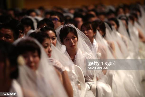 Brides waiting in the queue during an wedding ceremony of the Family Federation for World Peace and Unification commonly known as the Unification...