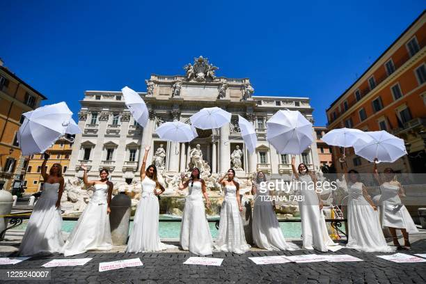 Brides wearing their wedding dress hold a flashmob protest against the postponement of their marriages due to the strict protocol of all religious...