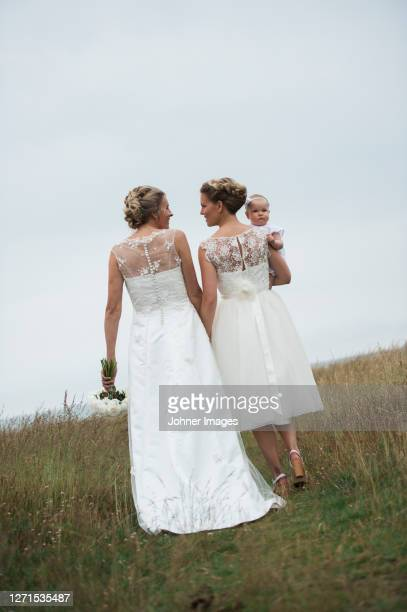 brides with baby girl - civil partnership stock pictures, royalty-free photos & images