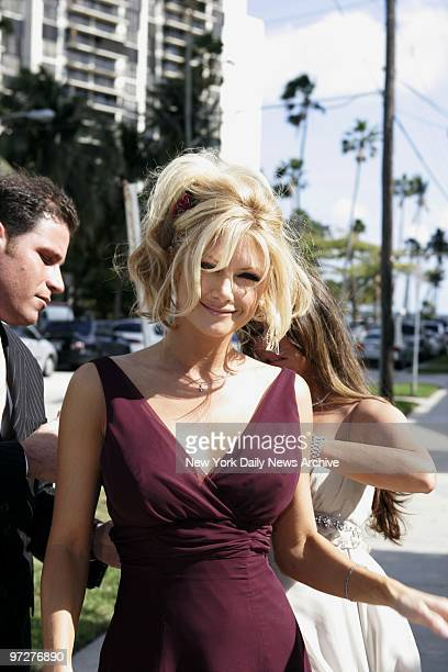 Bridesmaid and former 'Baywatch' beauty Brande Roderick has her dress adjusted as she arrives at St Jude's Catholic Church in Miami for the wedding...