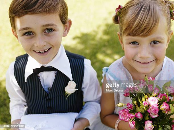"""bridesmaid and pageboy(6-7) smiling, close-up, portrait"" - ring bearer stock pictures, royalty-free photos & images"