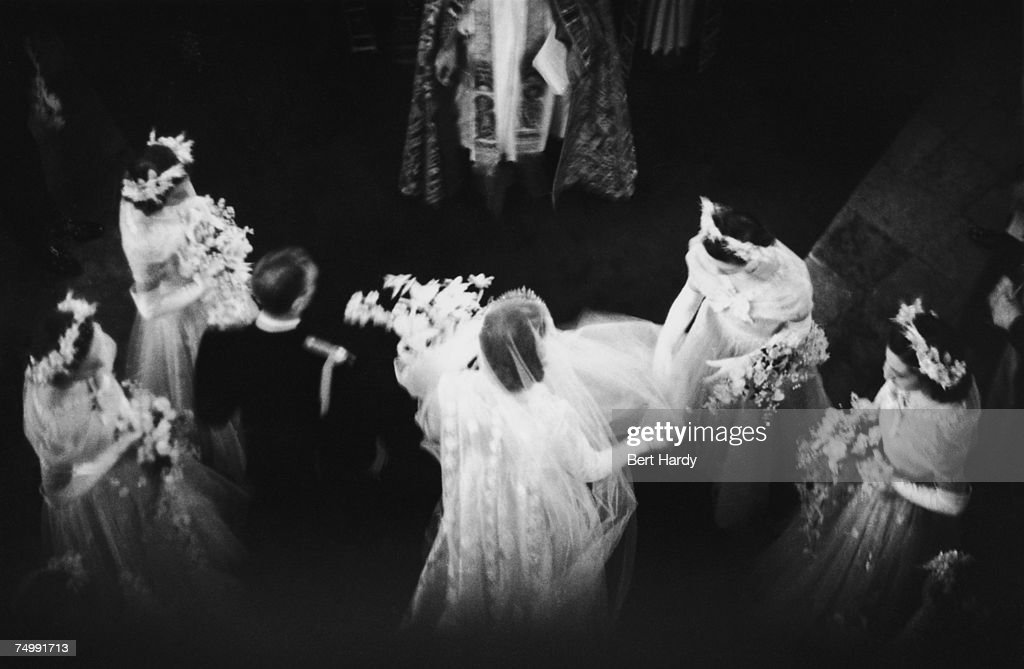 A bridesmaid arranging Princess Elizabeth's veil as she walks down the aisle with Lieutenant Philip Mountbatten (later Prince Philip, Duke of Edinburgh) at their wedding at Westminster Abbey, London, 20th November 1947. Original publication: Picture Post - 4438 - Royal Wedding - pub. 1947