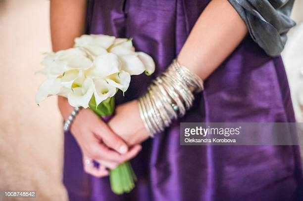 bridesmaid bouquet made up of white calla lilies. - calla lilies white stock pictures, royalty-free photos & images