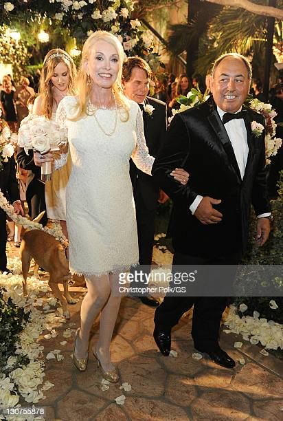Bridesmaid Janis Kaye and Groomsman Doc McGhee attend the wedding of Gene Simmons and Shannon Tweed at the Beverly Hills Hotel on October 1 2011 in...