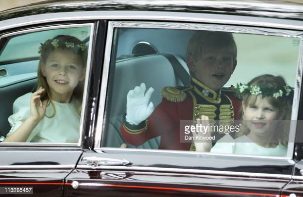 Bridesmaid Margarita ArmstrongJones page boy Tom Pettifer and bridesmaid Lady Louise Windsor wave as they arrive to attend the Royal Wedding of...