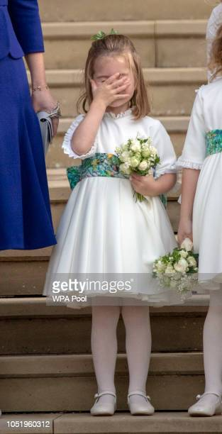 Bridesmaid Princess Charlotte of Cambridge on the steps of St George's Chapel in Windsor Castle after the wedding of Princess Eugenie and Jack...