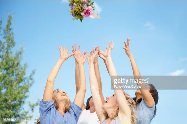 Bridesmaids Catching Bouquet