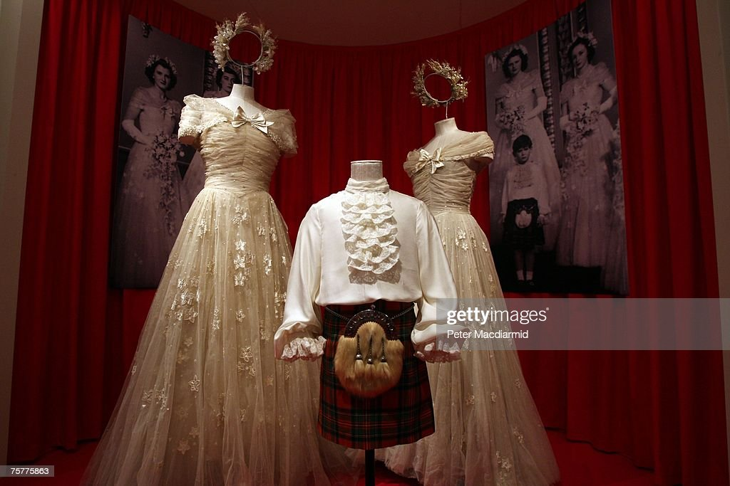 Bridesmaid's dresses and a page boy's outfit is displayed at the 'Royal Wedding: 20 Novermber 1957' exhibition at Buckingham Palace on July 27, 2007 in London. Queen Elizabeth II will be the first reigning sovereign to celebrate a 60th wedding anniversary. This new exhibition will mark the occasion by recreating the day in 1947 when Princess Elizabeth married The Duke of Edinburgh at Westminster Abbey. The collection of archive film footage, behind the scenes preparations, dresses, jewels and gifts reflect the mood of public rejoicing that swept the nation in the immediate aftermath of World War II.