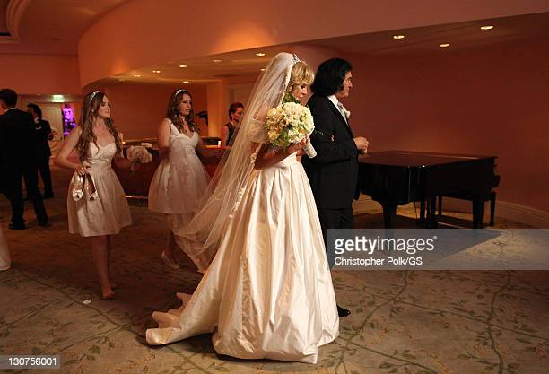 Bridesmaids Emily Field Sophie Tweed Simmons Bride Shannon Tweed and Groom Gene Simmons attend the wedding of Gene Simmons and Shannon Tweed held at...