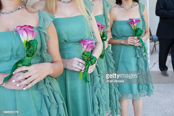 Bridesmaids holding bouquets of flowers