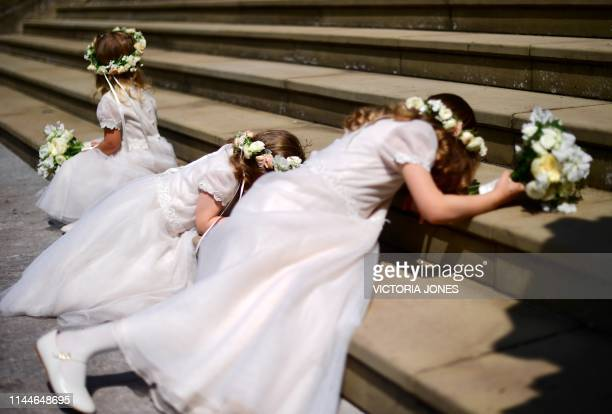Bridesmaids play on the steps of St George's Chapel in Windsor Castle, Windsor, west of London, on May 18 following the wedding of Lady Gabriella...