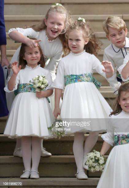 Bridesmaids Princess Charlotte of Cambridge Savannah Phillips Maud Windsor and page boy Prince George of Cambridge on the steps after the wedding of...