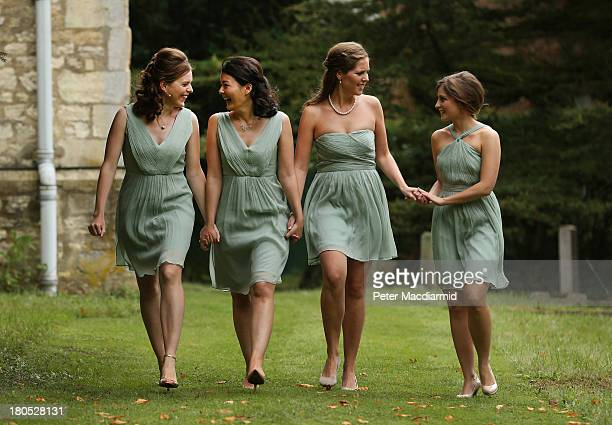 Bridesmaids walk from All Saints Parish Church to greet bride Suzanne Ashman for her wedding to Euan Blair on September 14 2013 in Wotton Underwood...