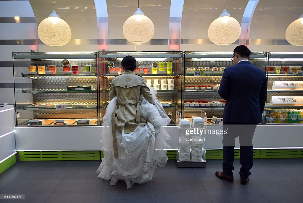 Bride-to-be, Echo Li and her fiance Charles Qian, choose lunch as they take a break during a pre-wedding photography shoot on October 11, 2016 in London, England. It's a Chinese custom for couples to have their wedding photos taken before they are married and on the wedding day the photos will be shown to guests on cards and big screens. Photography studios such as J.R Studios in east London have seen business boom as the capital has become increasingly popular as a location for pre-wedding photography thanks in part to its instantly recognisable landmarks.