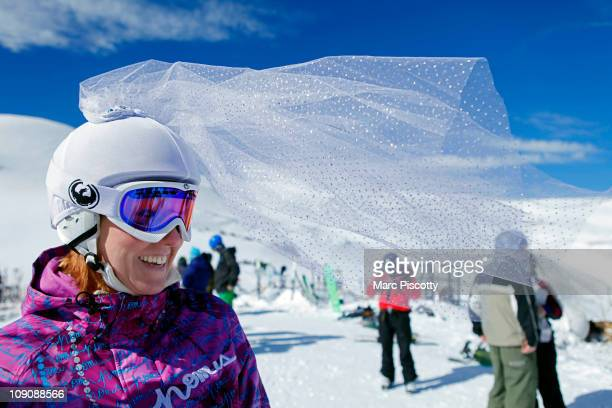Bridetobe Marie Leslie of Charlotte NC flashes a smile atop Loveland Ski Area in Colorado as her veil gets swept up in the wind at the 20th Annual...