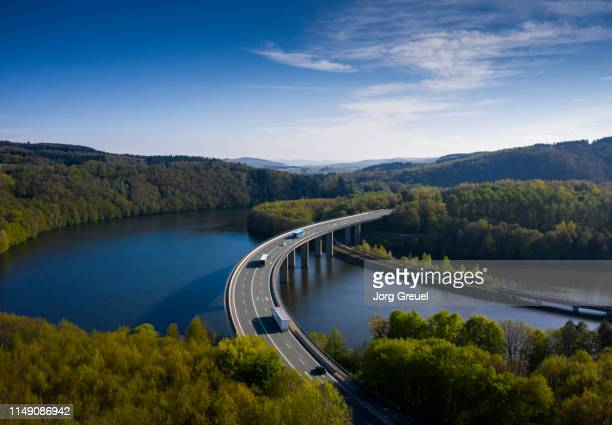 bridge across biggesee - north rhine westphalia stock pictures, royalty-free photos & images