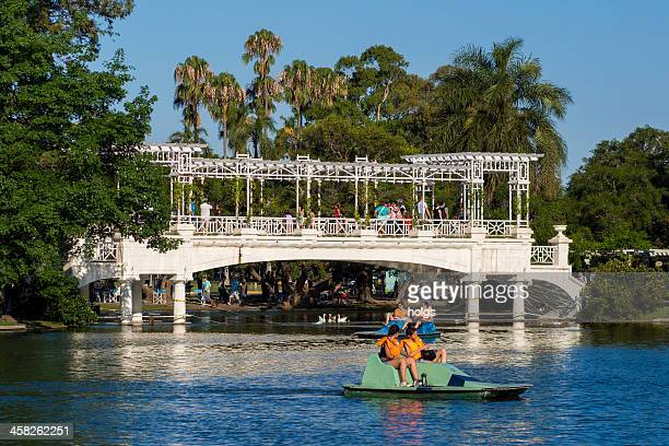 bridge across lake in february 3 park - palermo buenos aires stock photos and pictures
