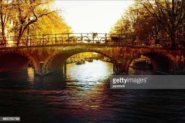 bridge across leidsegracht canal at sunset - arch stock pictures, royalty-free photos & images